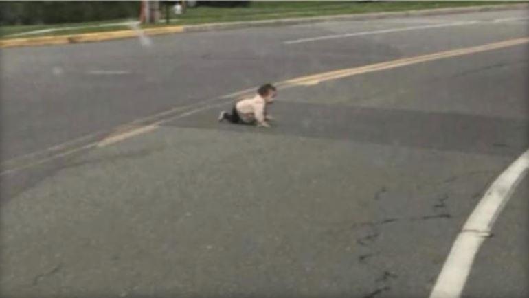 Baby in street